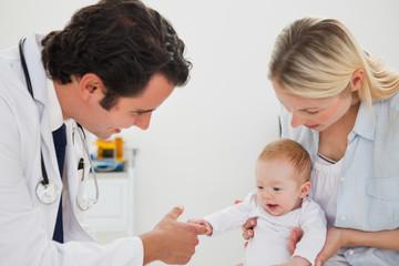 Baby grabbing doctors finger