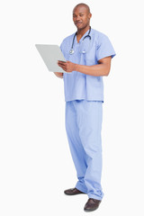 Doctor in scrubs with his clipboard