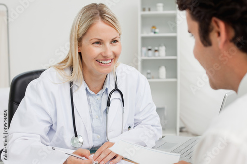 Smiling doctor talking with her patient