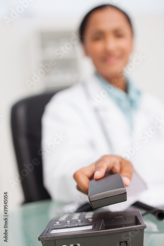 Phone being hung up by a doctor