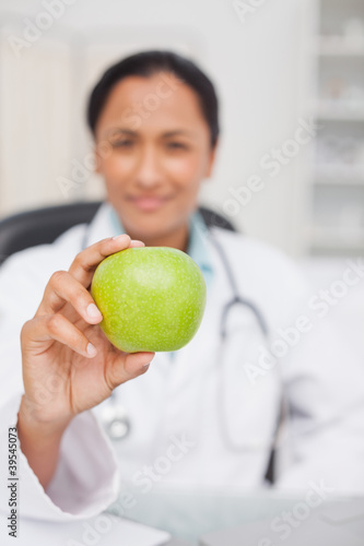 Beautiful green apple being held by a nurse