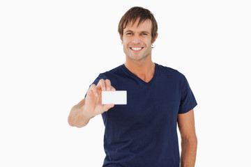 Smiling man holding a blank business card