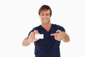 Blank business card being held by a smiling man