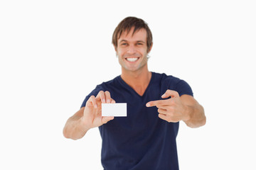 Blank business card being shown by a young man