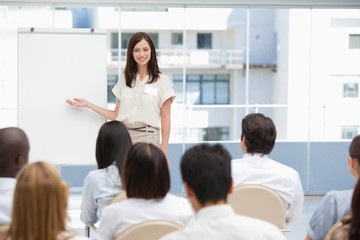 Businesswoman using a chart during a presentation