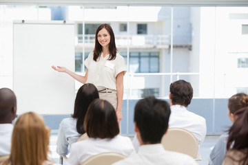 Smiling businesswoman using a chart during a presentation
