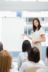 Woman smiling while giving a presentation