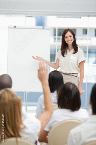 Woman smiling during a presentation