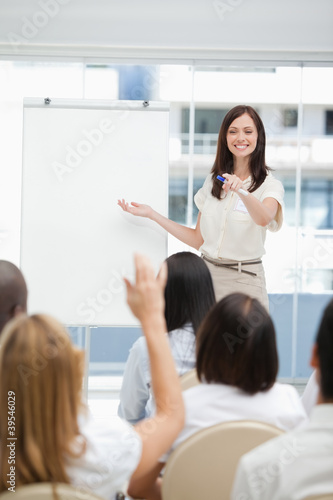 Woman pointing to the audience during a presentation