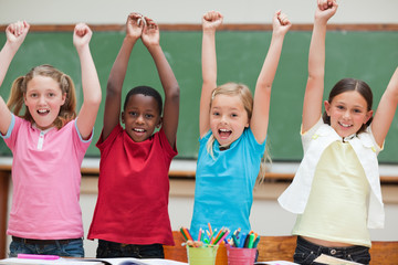 Cheering students standing in classroom