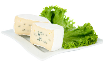 blue cheese with lettuce on a plate