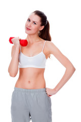 Pretty woman with red barbells posing against white background