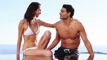 Couple sitting together in a swimming pool