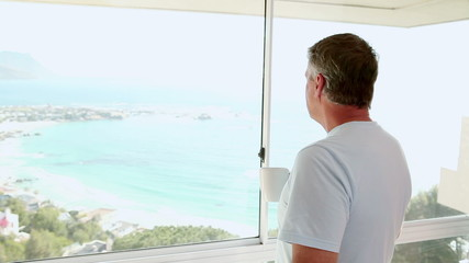 Mature man looking out at the beach