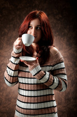 a woman drinks her coffee
