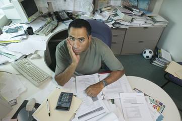 Portrait of businessman at desk
