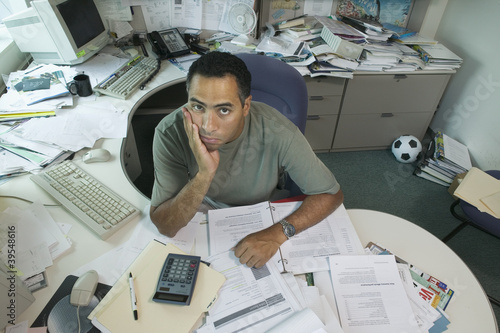 Portrait of businessman at desk