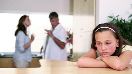 Child listening to her parents quarreling