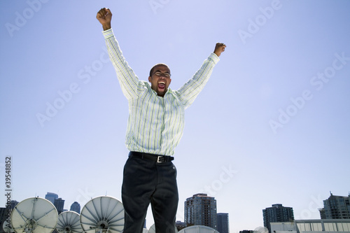 Businessman cheering with arms over head