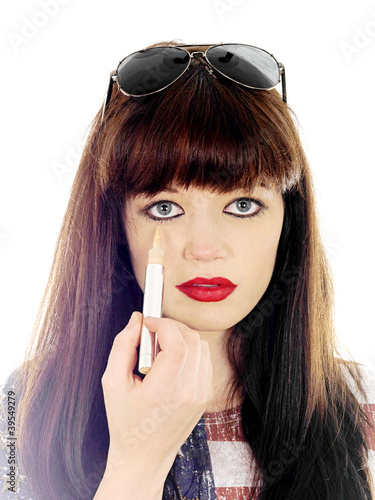 Young Woman Using Concealer. Model Released
