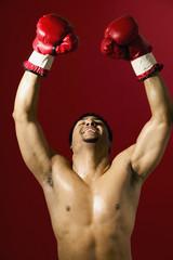 Portrait of male boxer celebrating