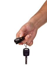 Hand holding car keys and a remote contro
