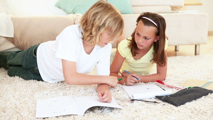 Siblings drawing together