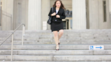 Businesswoman approaching from staircase