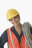 Portrait of female construction worker smiling