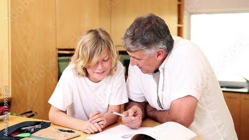 Father using a protractor with his son
