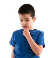 Child thinking with hand on his face