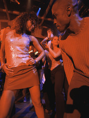 Young people dancing together at club