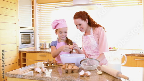 Woman cooking with her daughter