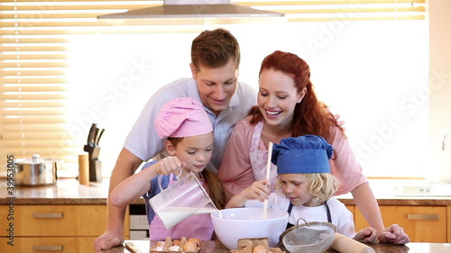 Family standing while cooking together
