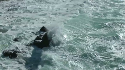 surf crashing on a rock