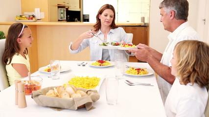 Happy family having dinner