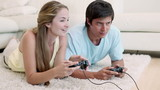 Woman winning in a video game against her boyfriend