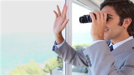 Businessman businessman looking through binoculars while waving
