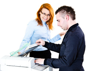 Young bussinessman and businesswoman during copying files