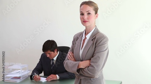 A blonde woman standing in an office