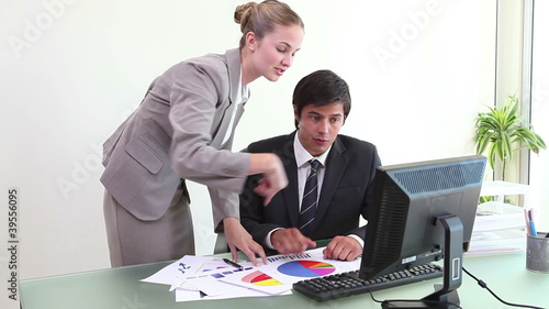 People wearing suits working together