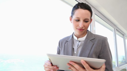 Businesswoman using a touch pad
