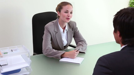 Businesswoman interviewing an applicant