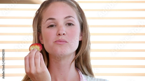 Video of a woman eating strawberry