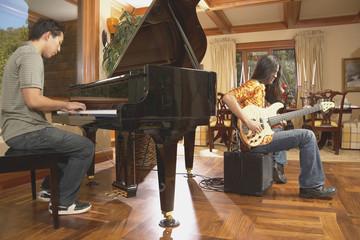 Men playing guitar and piano