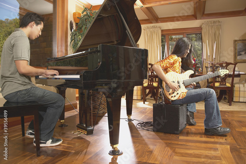 Men playing guitar and piano