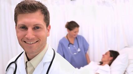 Doctor standing in front of his patient