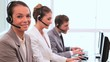 Smiling call centre agents working