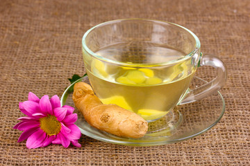Healthy ginger tea and flower on sackcloth