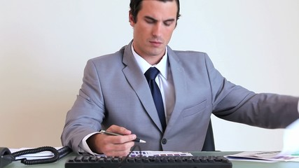 Businessman working while sitting at his desk